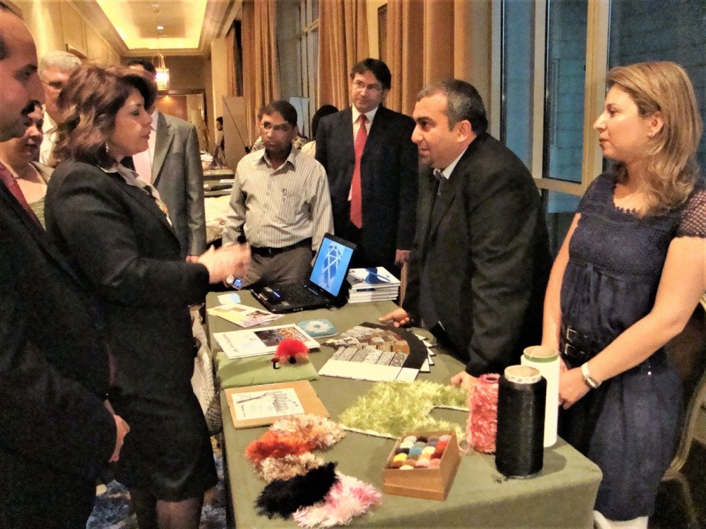 Imad HAIDAR, Owner and General Manager of Yamam Fancy Yarns & Tufts in SEBC Incubation Graduation Fair-Four Seasons Damascus Hotel, 2010, with lady minister of labor and Social Affairs
